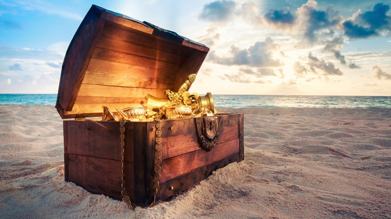 Open treasure chest on the beach