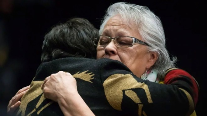 Reta Blind, right, sheds tears while embracing Viola Thomas at the final day of hearings at the National Inquiry into Missing and Murdered Indigenous Women and Girls, in Richmond, B.C., last year.