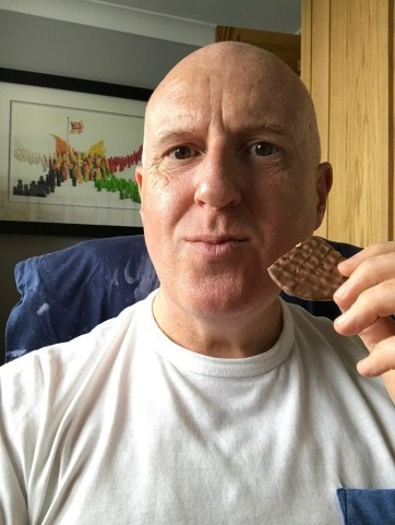Paul Kudray eating a biscuit